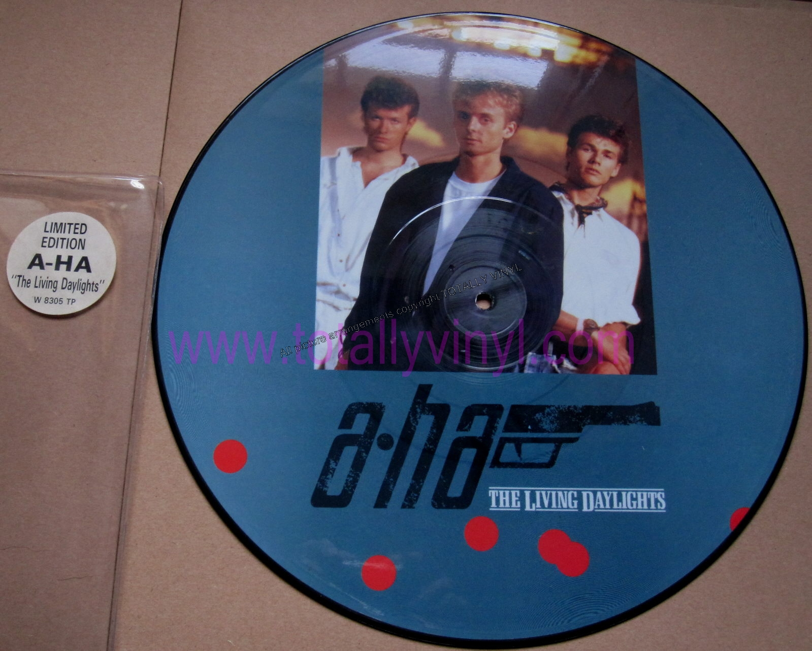 http://shop.totallyvinyl.com/img/uploads/images/aha/A_HA_THE_LIVING_DAYLIGHTS_PICTURE_DISC_12.jpg